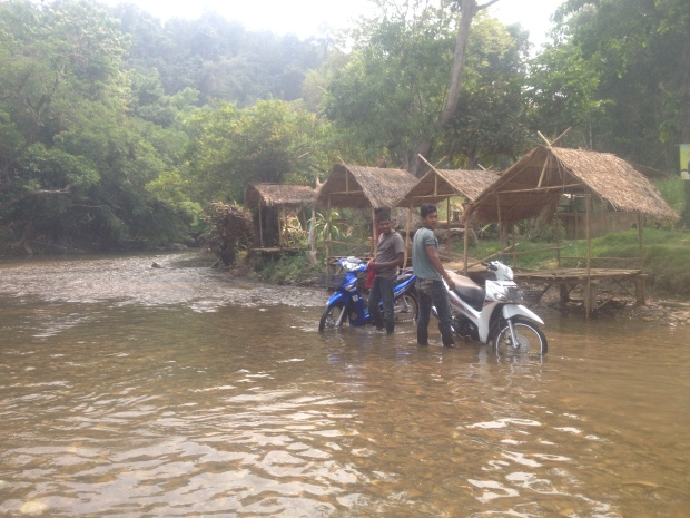 motorbikes in a river thailand